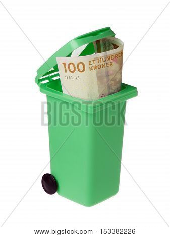 One undred Dannish kroner banknote inside an opened green recycling bin isolated on white background.