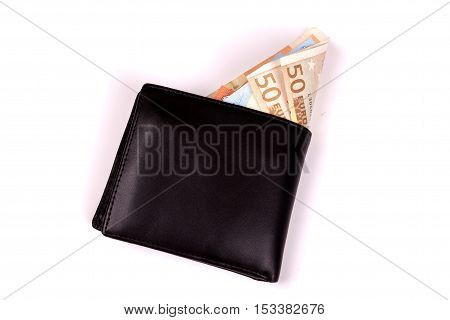 photo of Euros in a black leather wallet isolated on white background