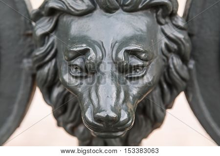 Iron antique lion head: design the gate with the heads of lions at the Museum Derzhavin Palace in Saint-Petersburg.