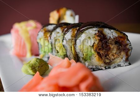 Pink rice paper butterfly and spider tempura sushi rolls