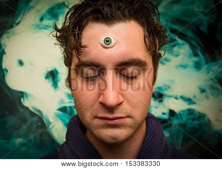 Handsome male fortune teller with magic third eye