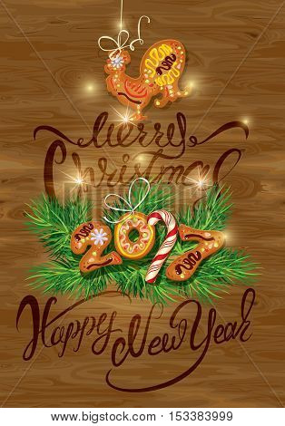 Hand written calligraphic text Merry Christmas and Happy New Year 2017 on wooden background. Year number as cookies. Winter holidays design. Stylized rooster from Chinese calendar.