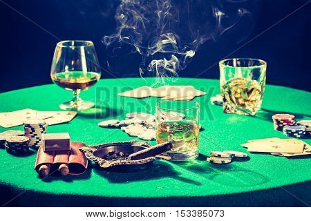 Old Gambling Table With Whiskey, Cigar And Cards