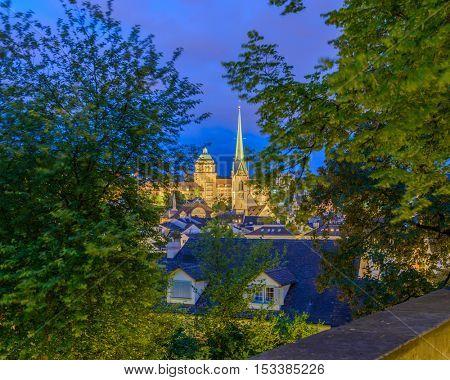 Illuminated window at dusk or night in Zurich, Switzerland.