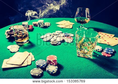 Closeup Of Gambling Table With Whiskey, Cigar And Cards