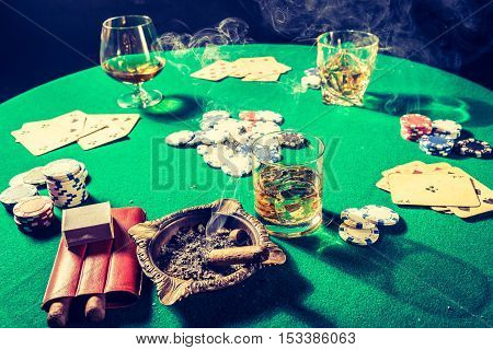 Whiskey, Cigar And Cards In Old Table For Poker