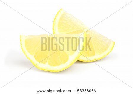 two wedges of fresh lemon on white background.