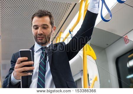 Businessman Commuter Traveling On The Metro Underground