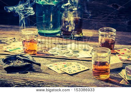 Vintage Illegal Gambling Table With Vodka, Cigarettes And Cards