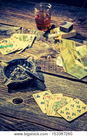 Cards And Money On Vintage Table For Illegal Poker