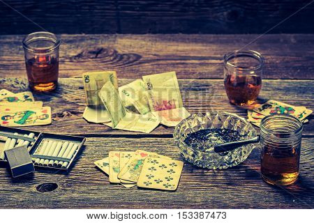 Cards And Money On Old Table For Illegal Poker