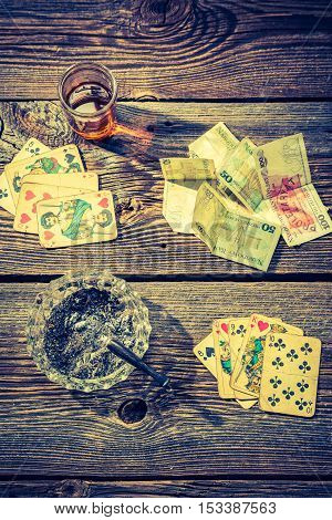 Cards And Money On Old Illegal Gambling Table