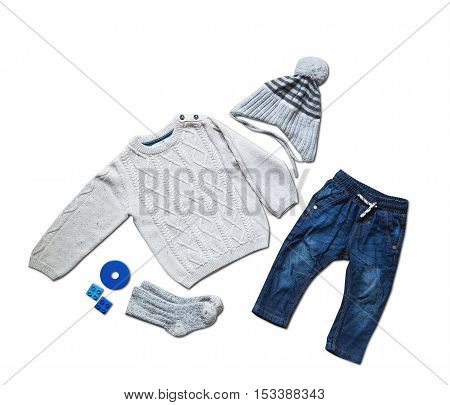 Baby clothes concept of child fashion. Flat lay children's clothing and accessories. Baby template background with copy space. Top view fashion trendy look of baby clothes and toy stuff.