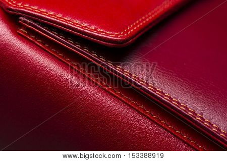 Red leather bag with pocket and stitches, woman's accessories, fashion industry, macro shot, selective focus, abstraction