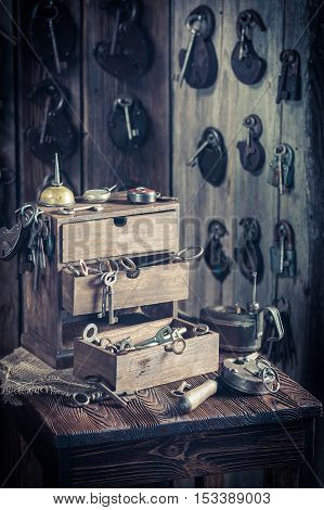 Aged Locksmiths Workshop With Tools To Repair