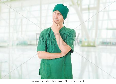 male doctor thinking at the hospital