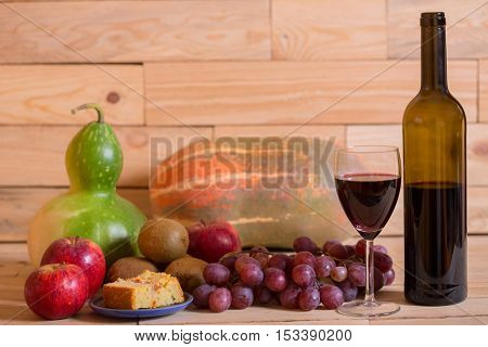 fruits and wine on wooden table, studio picture