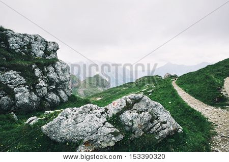 Nature landscape. Amazing view on Alps: valley and mountains at summer. Mangart is a mountain in the Julian Alps located between Italy and Slovenia.
