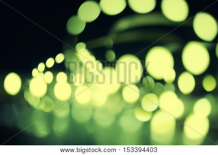 Christmas background. Defocused abstract background with bokeh blurred lights different size.