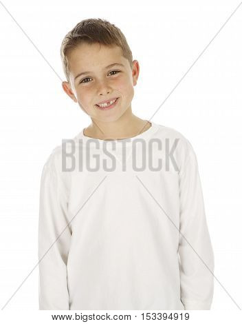 Handsome Seven Year Old Boy on a  White Background wearing a white long sleeve shirt.  He has a missing tooth