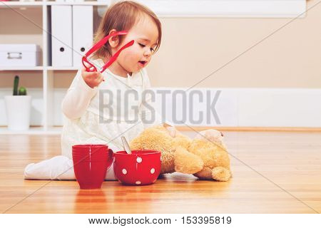 Toddler Girl Playing With Her Teddy Bear