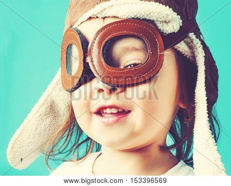 Happy Toddler Girl In Pilot Glasses