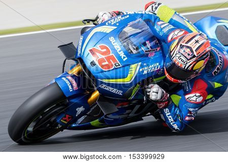 MELBOURNE AUSTRALIA – OCTOBER 23: Maverick Vinales (ESP) riding the #25 Team Susuki Ectsar's Suzuki during the 2016 Michelin Australian Motorcycle Grand Prix at 2106 Michelin Australian Motorcycle Grand Prix Australia on October 23 2016.