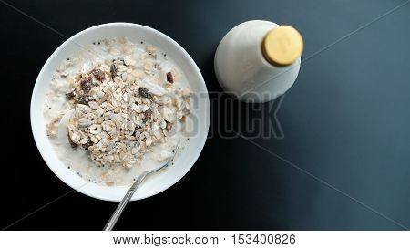 Morning Granola Breakfast With Raisins And Almond Served With Milk
