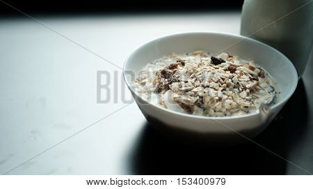 Morning granola breakfast with raisins and almond served with premium almond milk