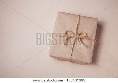 Classy Christmas gifts box presents on bright wooden background. Christmas and Happy New Year concept.