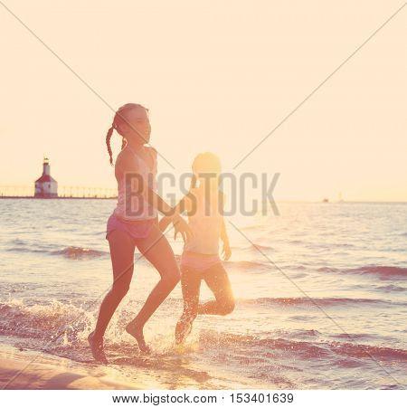 Girls running at the beach