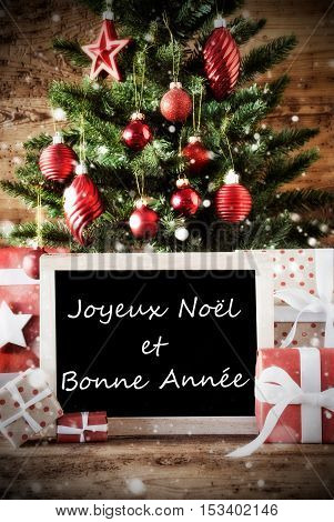Christmas Card With Tree And Balls. Gifts Or Presents In The Front Of Wooden Background. Chalkboard With French Text With Joyeux Noel et Bonne Annee Means Merry Christmas And Happy New Year