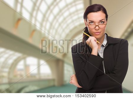 Serious Businesswoman Standing Inside Corporate Building.