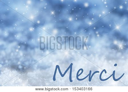 French Text Merci Means Thank You. Blue Sparkling Christmas Background Or Texture With Snow. Copy Space For Your Text Here