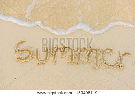 Summer text with white sandy beach and sea