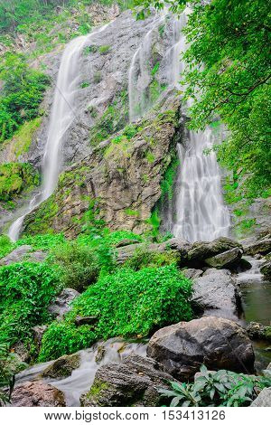 Forest waterfall; Khlong lan waterfall famous natural tourist attraction in Kampang Phet province Thailand.