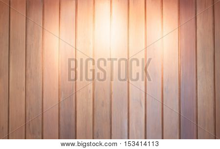 Spot light on wooden wall background, stock photo