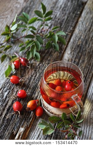 Rosehip tea in glass cup and berries