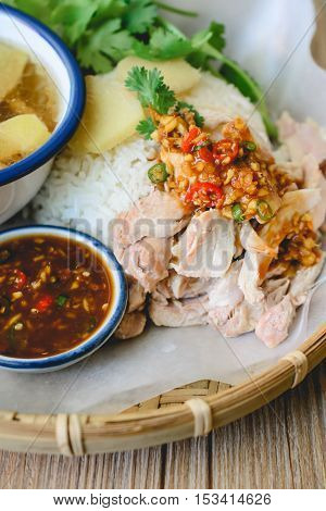 Delicious Hainanese chicken rice on wood background