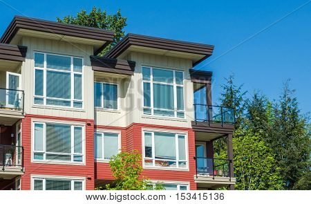 The top of apartment building on blue sky background