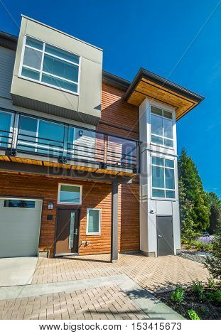 Brand new townhouse building on sunny day in British Columbia