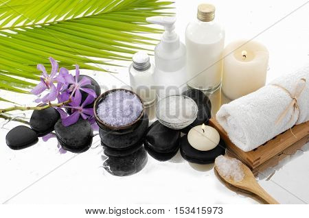 spa concept with palm ,towel, orchid, stones, oil