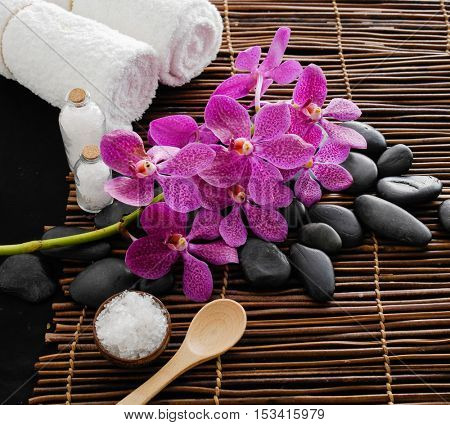 Bouquet orchid with towel with stone ,spoon on mat