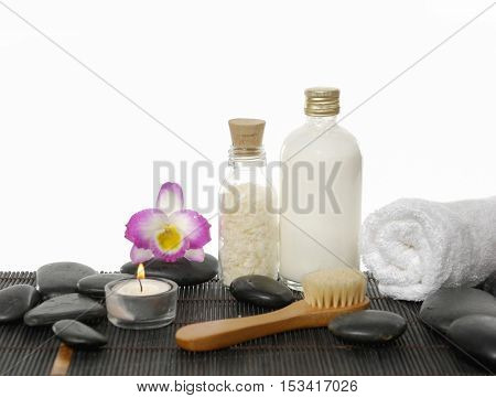 Set of black stones with ,candle ,orchid. Towel on mat