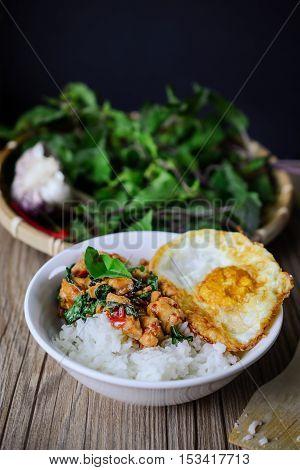 Kapro Gai Kai Dao, Stir Fried Basil Cicken on wooden Thai Famous Food Thai Street Food Thai Cuisine Thai Spicy Food
