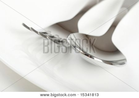 Photo of fork and spoon on plate
