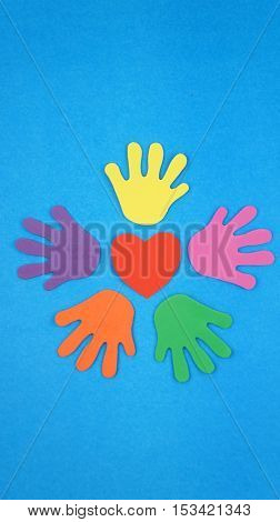 Colorful hand over blue background
