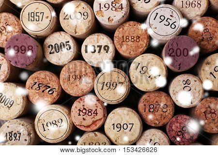 Different wine corks background. Snowy effect, Christmas celebration concept.