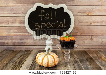 Fall cupcake with gourd and chalkboard sign