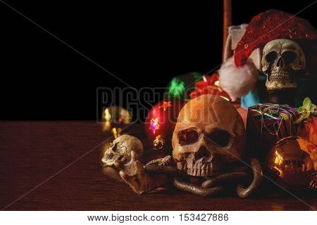 Skull on a wooden table with gifts for the festival.
